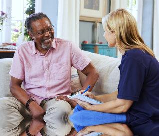 senior man and a caregiver talking