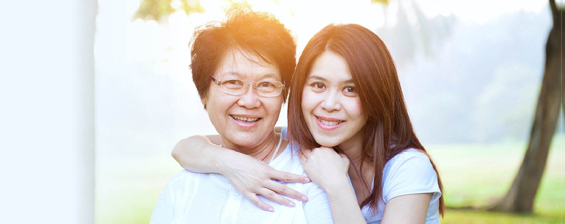 elder woman and a caregiver smiling