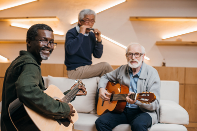 group of senior men having music activity